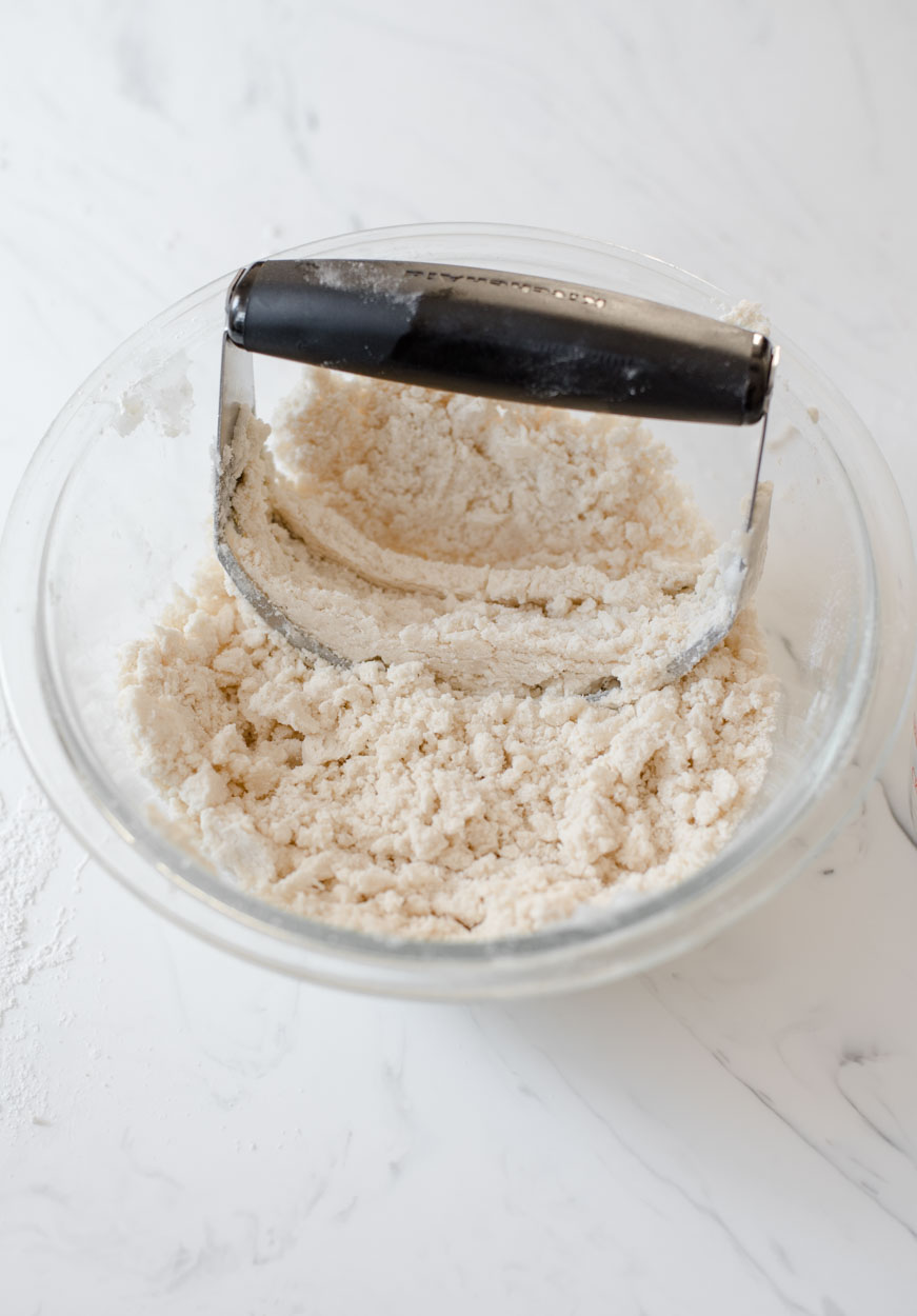 process shot of pie dough forming