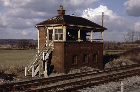 The derelict signal box at Lavington, 28/02/1979.  It seems remarkable that it should have just been left in this condition after having been made redundant: tiles and windows are missing, but the levers can still be seen in situ
