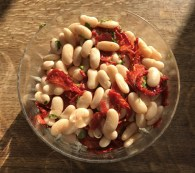 Czar beans with home dried tomatoes, fresh coriander and a citrus dressing