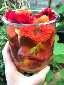 fill the jar with flowers and add the vinegar