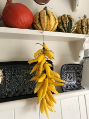 Lemon Drop chillies drying in my kitchen