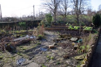 front garden - the beds and paved area