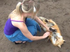 Kay Fedewa and her Russian domesticated fox, Anya