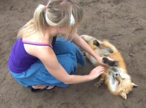 Kay Fedewa and her Russian domesticated fox, Anya