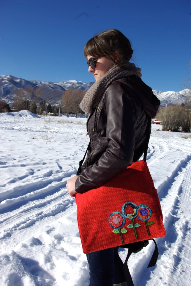 appliqué flowers, red messenger bag