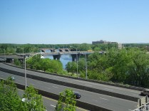 From the Connecticut Convention Center looking out over Mortensen Plaza. the closest bridge is the Founders with a walkway to Great River Park. The distant bridge is the Bulkeley Bridge.