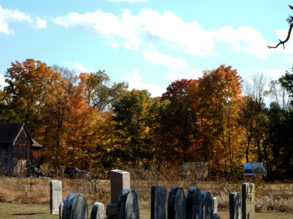 Totally random. Cemetery, barn, old trucks.