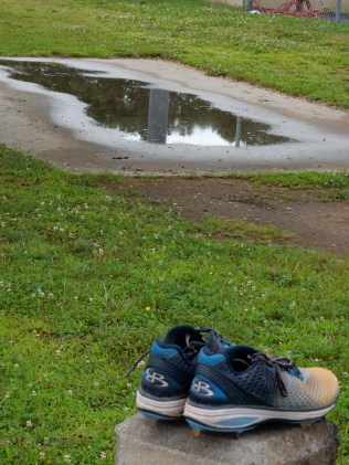 Odd that the shoes were left here, but that puddle looks like it has some nice reflections