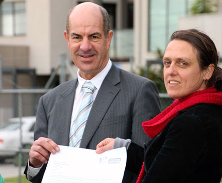 Kelvin Thomson MP receiving a petition from Ellen Roberts of Climate Action Moreland on 13 June 2012