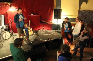 Adrian Whitehead and son on stage launching the Save the Planet Party