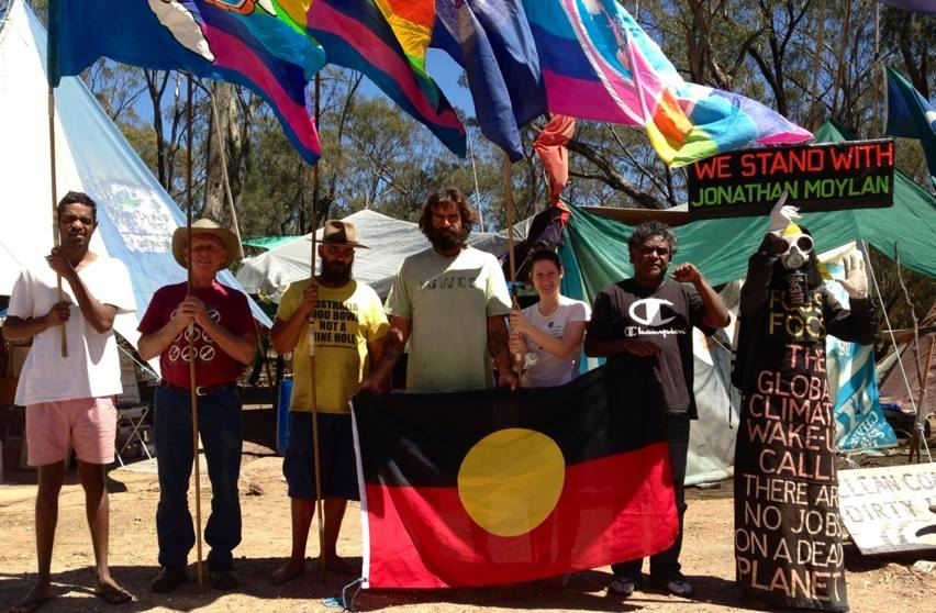Iris Ray Nunn at the Leard Forest - standing against CSG