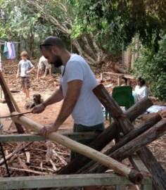 Elliot Giakalis assisting in the carving of Yidaki (didgeridoo) for Garma Festival.