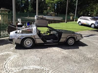 Delorian from BTTF outside QLD Parliament by KAP to highlight reversal of Qld under Newman Government.