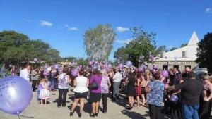 Brisbane Times: Mourners release purple balloons in memory of Talieha.
