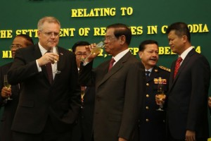 """The Cambodia Herald: """"The MOU (Memorandum of Understanding) was signed between Cambodia's Deputy Prime Minister and Interior Minister Sar Kheng, and Australia's Immigration Minister Scott Morrison who is in Cambodia for a two-day visit."""""""