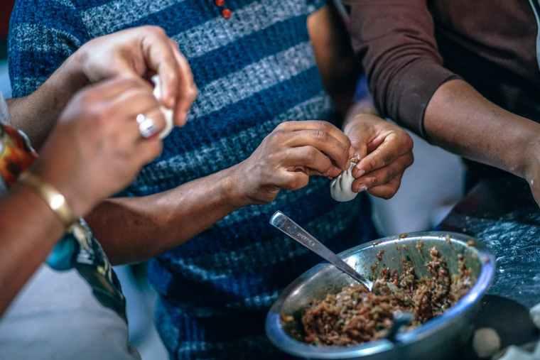 photo of people making dumplings