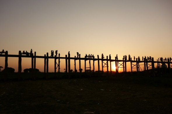 U Bein bridge silhouetted against the setting sun