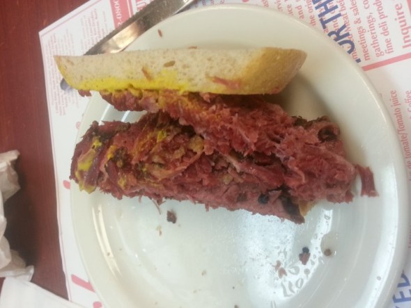 half a smoked meat sandwich - lots of thinly sliced beef