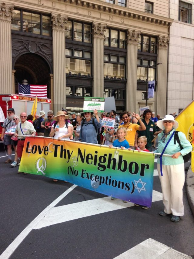 Rich Richardson and Marguerite Chandler With Love Thy Neighbor banner.