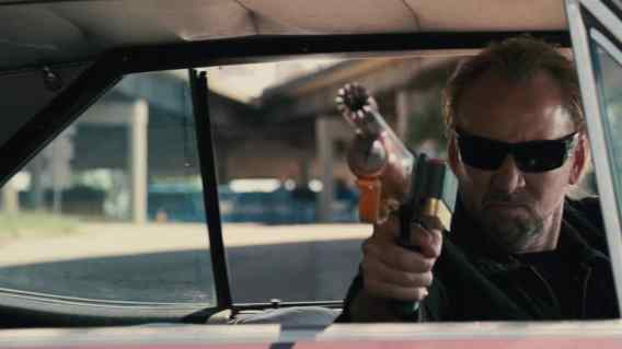 Nicolas Cage with a Gun