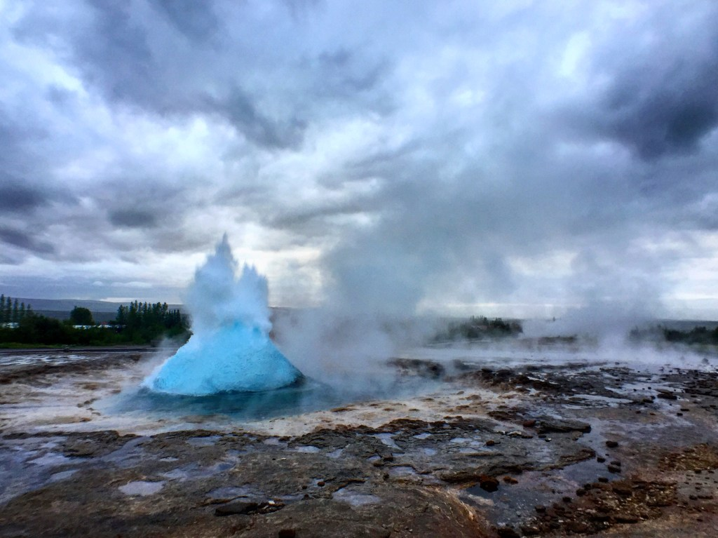 Geysir bubbling up and just about to explode