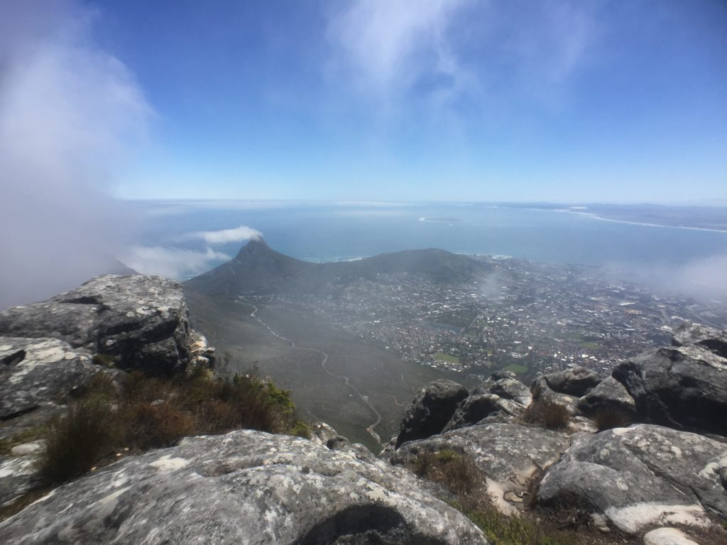 Rocky outcropping and blue sky view over Cape Town from the top of Table Mountain