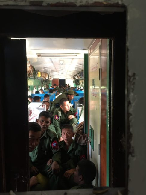 Burmese soldiers on the train