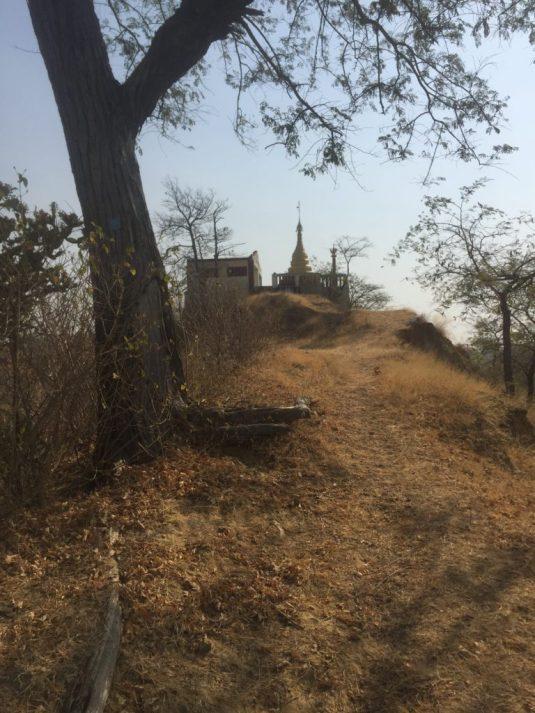 Buddhist pagoda atop a scrubby hill