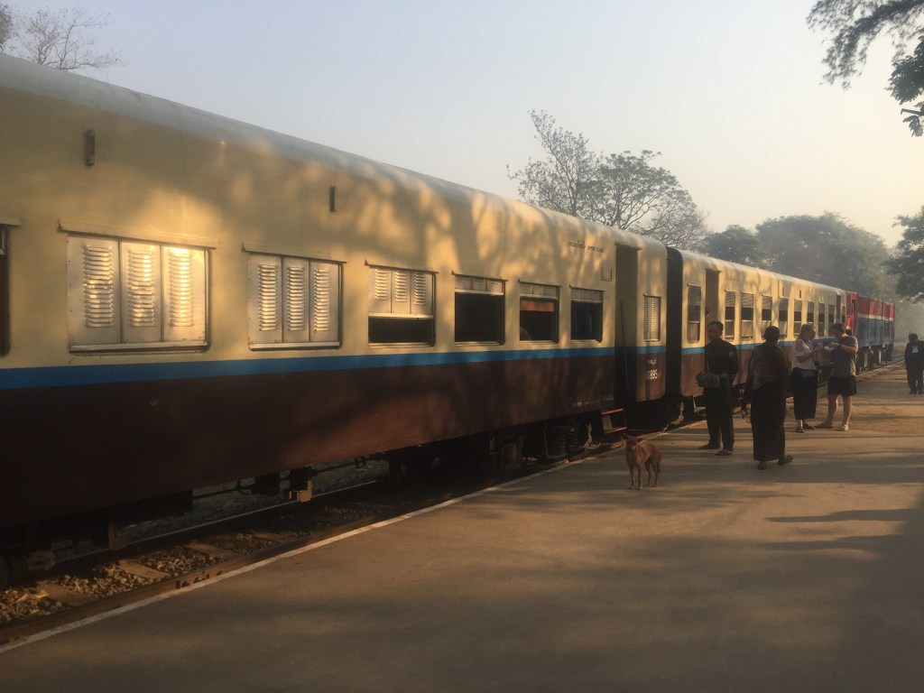 Brown and white train sits on the platform at Pyin Oo Lwin before departing for the Goteik Viaduct