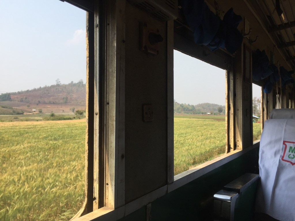 Looking out the train windows at the Burmese countryside
