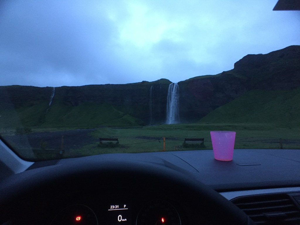 Seljalandsfoss waterfall viewed from the front seat of my car