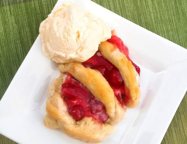 Looking for a Christmas dessert or breakfast idea? Try this easy candy cane cherry cheese danish with crescent rolls and cream cheese. SO good and festive for your holiday meal.