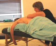Massage therapist working