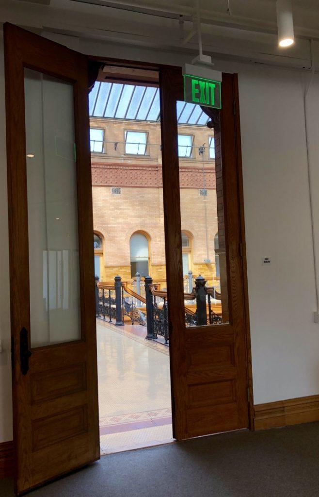 View through massive doors out to the atrium of The Bradbury