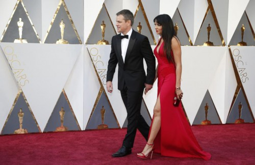 "Matt Damon, nominated for Best Actor for his role in ""The Martian,"" arrives with his wife Luciana Barroso. REUTERS/Lucy Nicholson"