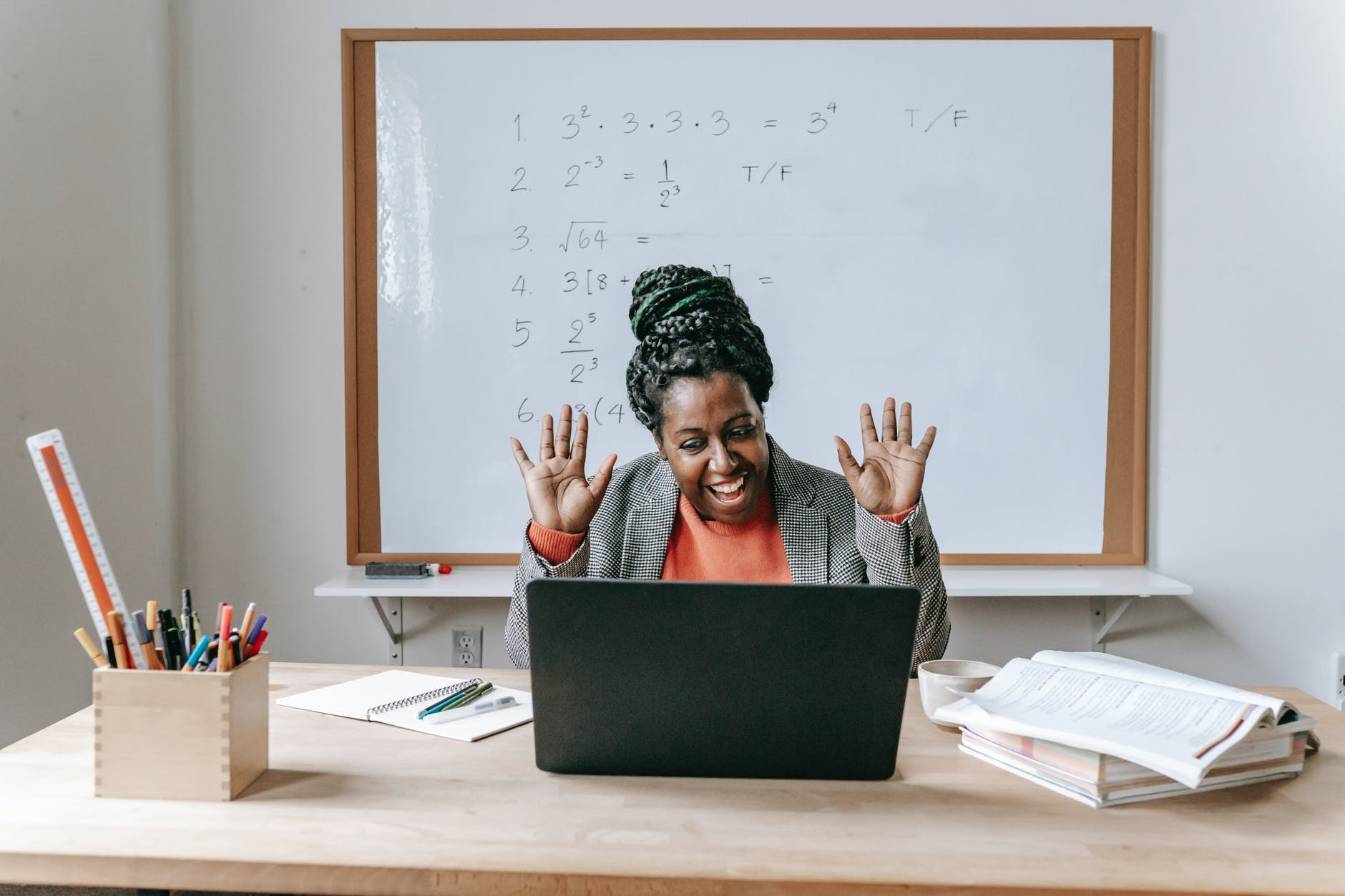 happy black woman using laptop for online work