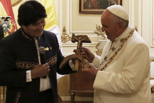 Bolivian President Evo Morales presents Pope Francis with a crucifix incorporating the hammer and sickle symbol during a meeting at the presidential palace in La Paz. Photo: Juan Carlos Usnayo/Agence France-Presse/Getty Images