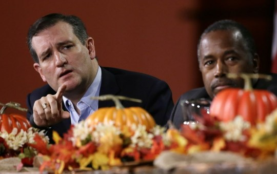 Republican presidential candidate, Sen. Ted Cruz, R-Texas, left, speaks during the Presidential Family Forum as Ben Carson listens, Friday, Nov. 20, 2015, in Des Moines, Iowa. (AP Photo/Charlie Neibergall)