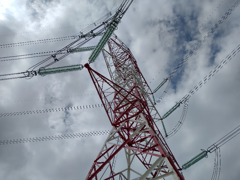 A picture containing outdoor object, pylon  Description automatically generated