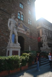This reproduction of Michelangelo's David stands at the entrance of the Palazzo Vecchio. Hercules and Cacus stand on the other side of the doorway.