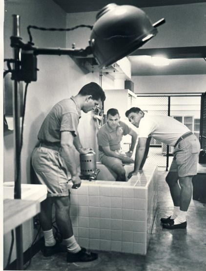 "Coaches Andy Bourgeois (SA '56), Emile ""Chubby"" Marks (SA '46), and Bob Conlin. (Clarion Herald photo)"