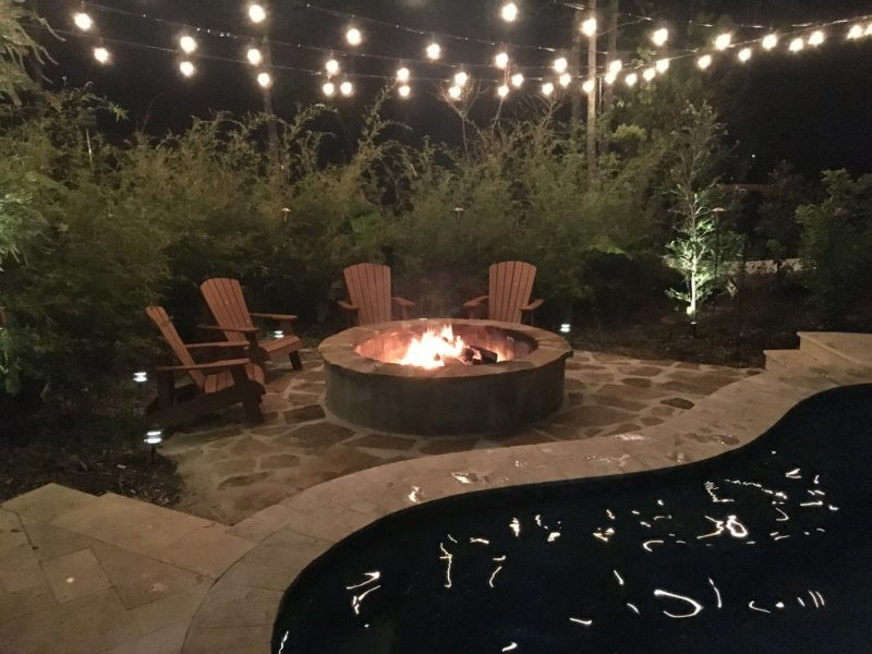 Flagstone Fire Pit And String Lights By A Pool Crystal