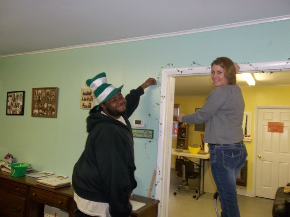 """Hang on People!""- Amy    Here is Robert and Suzie getting our place all green for St. Patrick's Day!"