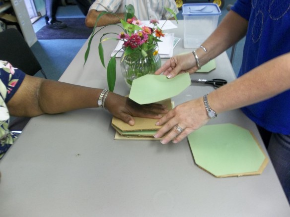 """Maggie and Suzie trying out our flower press!  """"Hope the flowers don't mind!""""- Amy"""