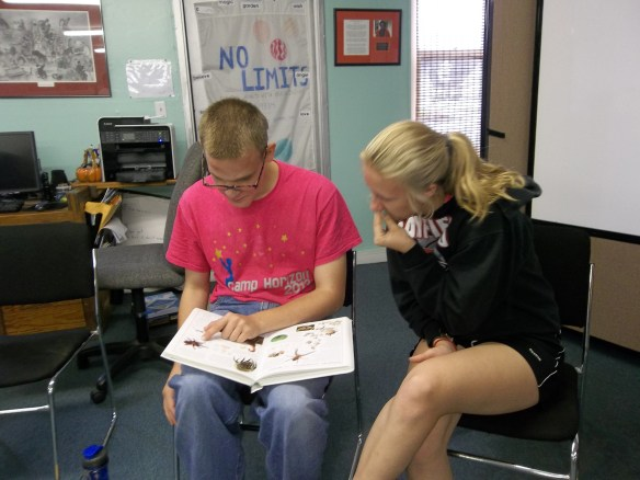 "Brandon and Logan (from youth works) enjoying a good book.  ""You know Brandon loves his bugs!""-  Amy"