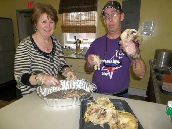 "Amy and David cooking some chicken and rice for the Soup Kitchen.  We even got to try a sample and it was awesome!  ""More please!  Mmm mmm mmm!!"" says Amy."
