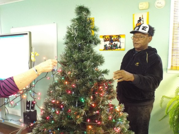 John decorating the tree.  Decorate on John, with your bad self!