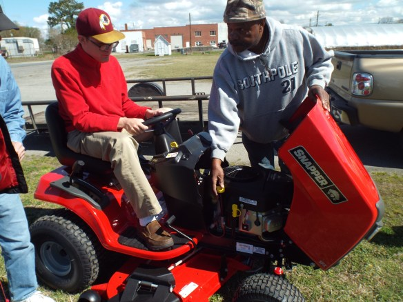 Brandon sits tight learning the ins and outs of of the new mower.