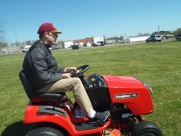 Brandon on the mower. Lookin' good Brandon!