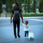 Daddy duties! Flavour steps out with his daughter, Sophia (photo)
